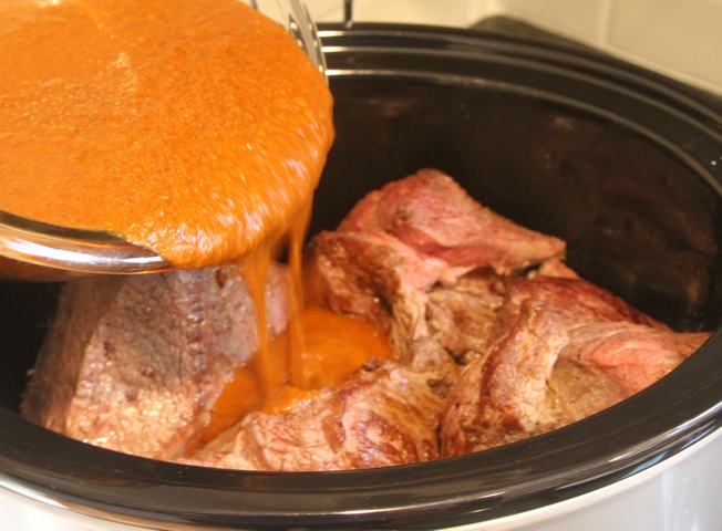 Paleo spirit barbacoa sauce on beef in crockpot