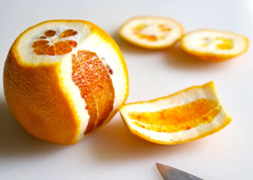 cutting rind off blood orange