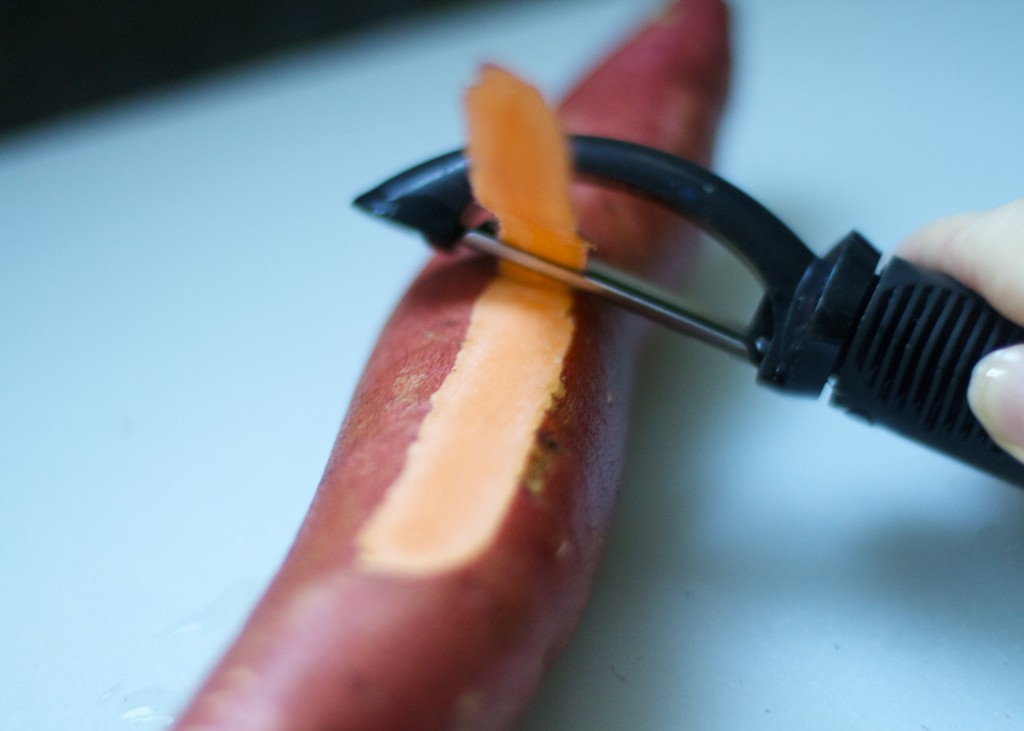 peeling a sweet potato