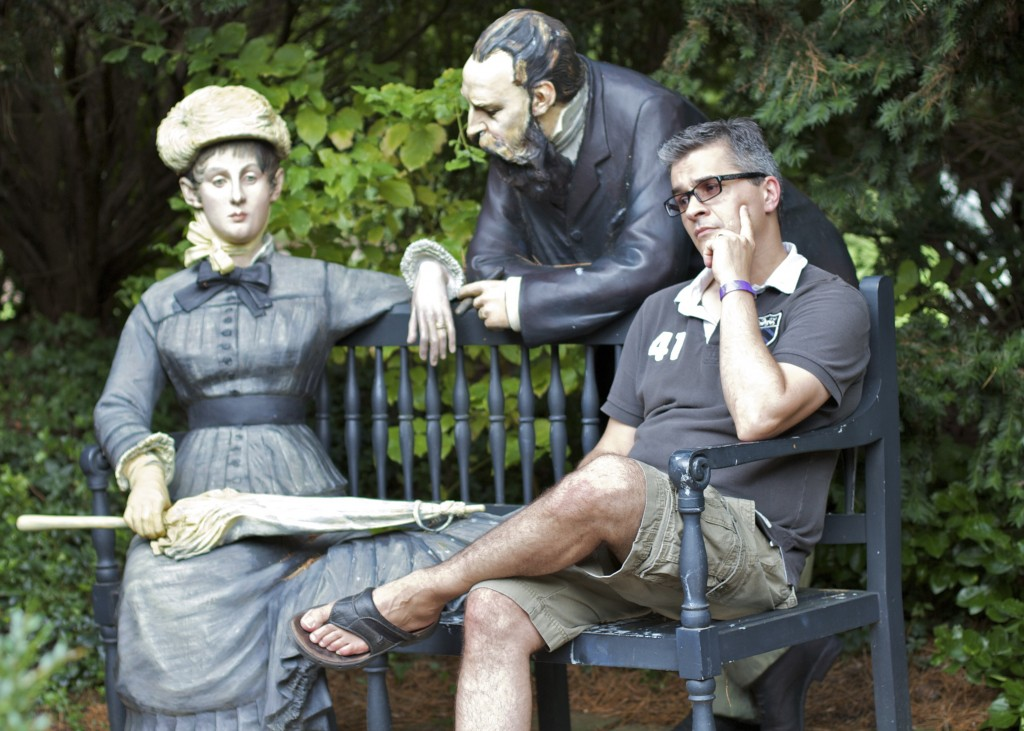"""G contemplates his fall off the paleo wagon. (At """"Grounds for Sculpture"""" in New Jersey)"""