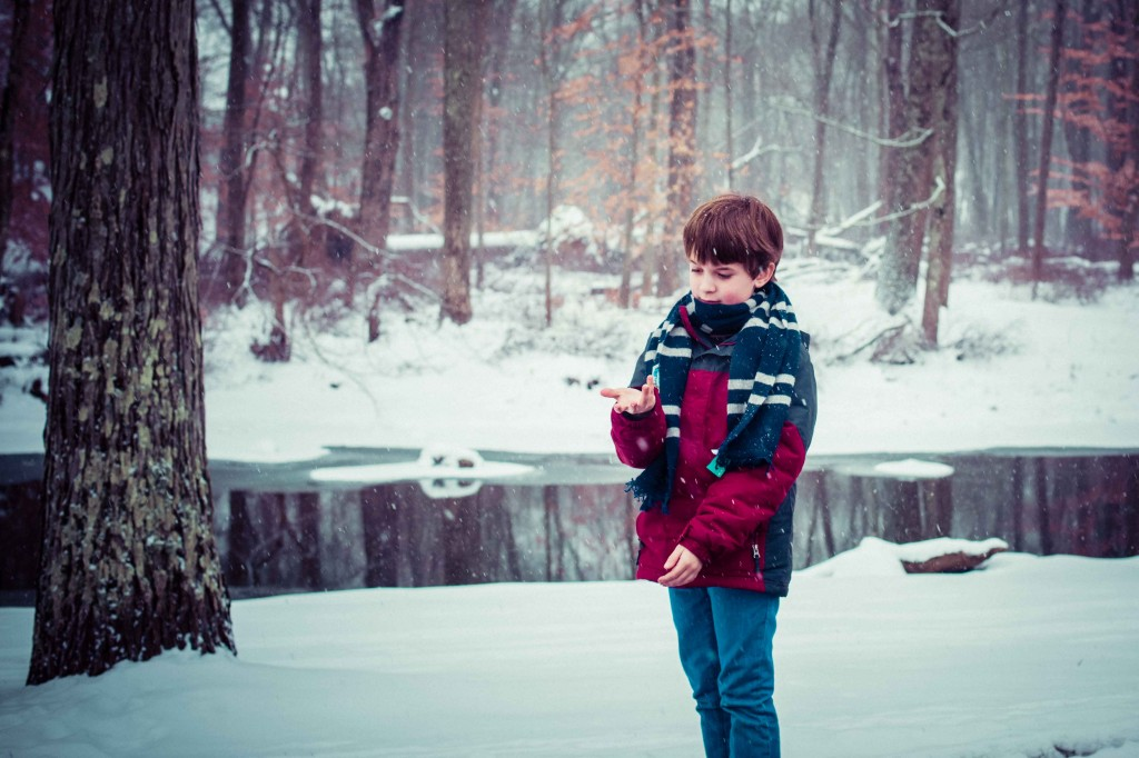 Boy with Snow   Photo by Lea Valle